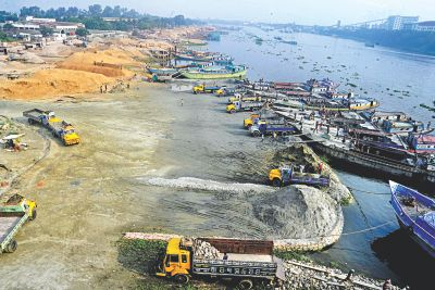 A major portion of river Shitalakkhya, almost up to its middle, is filled up by sand traders near Kanchpur Bridge in Naryanganj