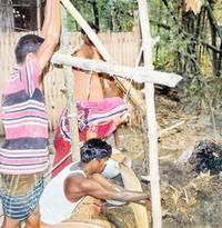 Traditional drilling -first digging a hole, water, pipie and movement om 4 bamboos platfom- faridpur